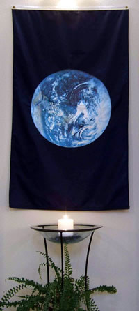 peace candle with earth flag