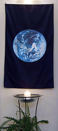 peace candle and earth flag